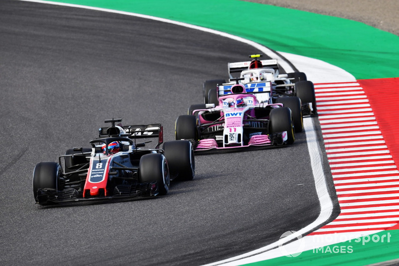 Romain Grosjean, Haas F1 Team VF-18, Sergio Perez, Racing Point Force India VJM11 and Charles Leclerc, Sauber C37 battle