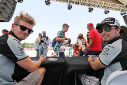 (L to R): Nico Hulkenberg, Sahara Force India F1 and team mate Sergio Perez, Sahara Force India F1 sign autographs for the fans