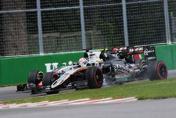 Sergio Perez, Sahara Force India F1 VJM09 and Romain Grosjean, Haas F1 Team VF-16 battle for positio