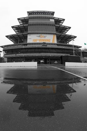 The Pagoda is reflected in a puddle of rain water