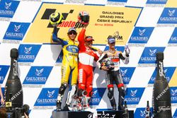 Podium: Race winner Loris Capirossi, Ducati; second place Valentino Rossi, Yamaha; third place Dani