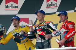 Podium: race winner Valentino Rossi, Repsol Honda Team, second place Max Biaggi, Pramac Pons, third