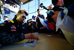 Daniil Kvyat, Red Bull Racing signs autographs for the fans