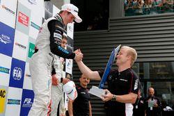 Podium, Joel Eriksson, Motopark, Dallara F312 - Volkswagen getting the trophy of Felix Rosenqvist, 2