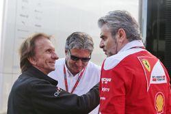 Emerson Fittipaldi, with Pasquale Lattuneddu of the FOM and Maurizio Arrivabene, Ferrari Team Principal