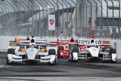 Juan Pablo Montoya, Team Penske Chevrolet passes Helio Castroneves, Team Penske Chevrolet