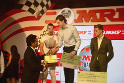 Sachin Tendulkar with MRF Challenge champion Harrison Newey, second place Joey Mawson, third place Mick Schumacher