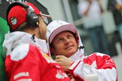 Kimi Raikkonen, Ferrari with team mate Sebastian Vettel, Ferrari on the drivers parade