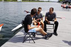 Tom Clarkson interviews Stoffel Vandoorne, McLaren, Matt Morris, Engineering Director, McLaren, beside the rowing lake