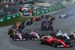Kimi Raikkonen, Ferrari SF70H, Sergio Perez, Sahara Force India VJM10 and Esteban Ocon, Sahara Force India VJM10 at the start of the race