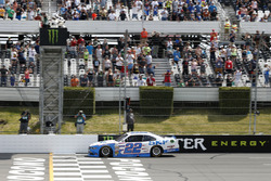 Brad Keselowski, Team Penske Ford, takes the checkered flag