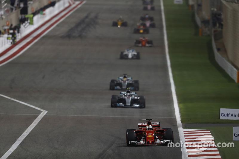 Sebastian Vettel, Ferrari SF70H, leads Valtteri Bottas, Mercedes AMG F1 W08, and Lewis Hamilton, Mercedes AMG F1 W08