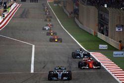 Valtteri Bottas, Mercedes AMG F1 W08, leads Sebastian Vettel, Ferrari SF70H, and Lewis Hamilton, Mercedes AMG F1 W08
