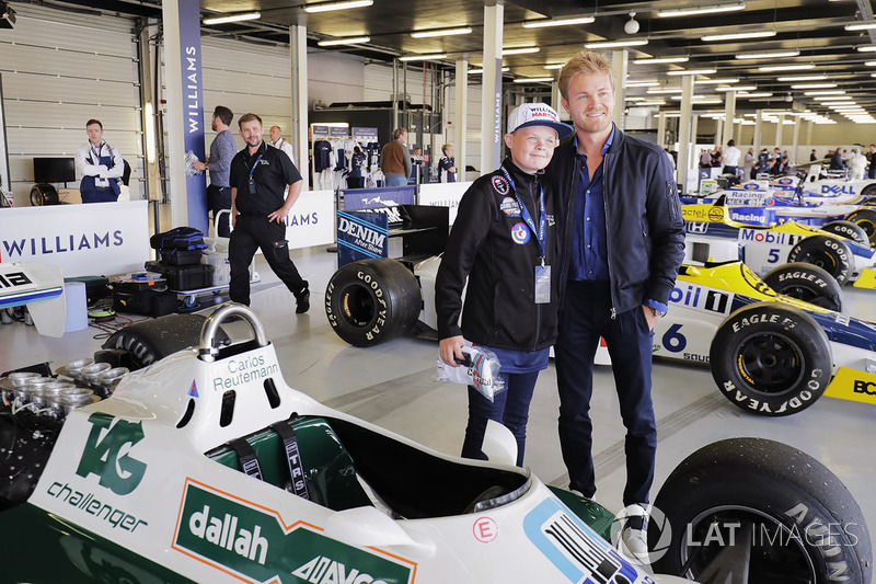 Nico Rosberg poses with a young fan