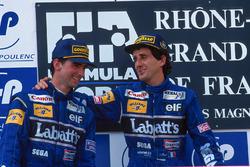 Podio: il vincitore della gara Alain Prost, il secondo classificato Damon Hill