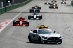 The Safety Car leads Sebastian Vettel, Ferrari SF71H, Lewis Hamilton, Mercedes AMG F1 W09, and Valtteri Bottas, Mercedes AMG F1 W09