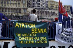 Fans with banners show their feelings about the loss of Ayrton Senna, Williams at the previous race