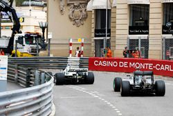 Keke Rosberg leads his son Nico Rosberg as they lap the circuit in their respective Championship winning cars