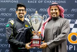 Ahmed Bin Khanen is presented with a trophy by Prince Khaled Al Faisal, President of the Motor Feder