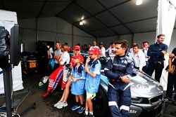 Bruce Correa, safety car driver, watches the World Cup final in the garage with fans