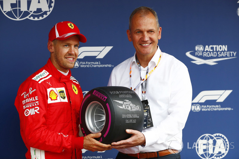 Sebastian Vettel, Ferrari, receives the Pirelli pole award