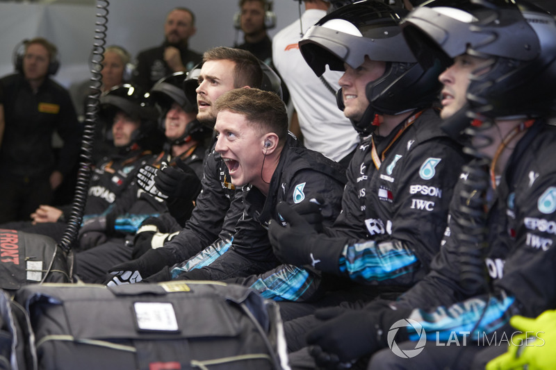 Mercedes pit crew cheer in the garage