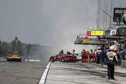 #63 Scuderia Corsa Ferrari 488 GT3, GTD: Cooper MacNeil, Gunnar Jeannette, Jeff Segal, pit stop, fire