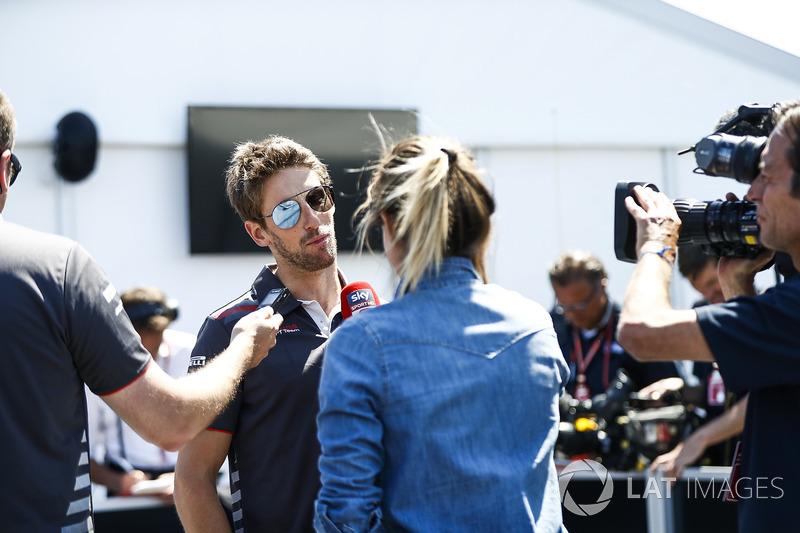 Romain Grosjean, Haas F1 Team, speaks to a reporter