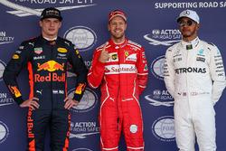 Pole winner Sebastian Vettel, Ferrari, talks to sceond place Max Verstappen, Red Bull Racing, third place Lewis Hamilton, Mercedes AMG F1