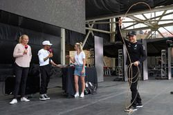 Valtteri Bottas, Mercedes AMG F1, is given a lesson on how to use a lasso, on the F1 stage