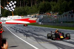 Max Verstappen, Red Bull Racing RB14, takes the chequered flag ahead of Kimi Raikkonen, Ferrari SF71H, and Sebastian Vettel, Ferrari SF71H