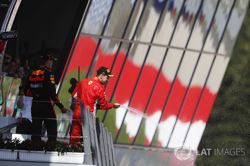 Podium: third place Sebastian Vettel, Ferrari, sprays champagne on the podium, along with race winner Max Verstappen, Red Bull Racing