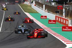 Sebastian Vettel, Ferrari SF71H, Valtteri Bottas, Mercedes AMG F1 W09, Kimi Raikkonen, Ferrari SF71H and Max Verstappen, Red Bull Racing RB14