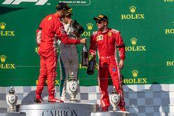 Sebastian Vettel, Ferrari, Lewis Hamilton, Mercedes-AMG F1 and Kimi Raikkonen, Ferrari celebrate on the podium with the champagne