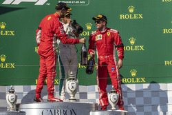 Sebastian Vettel, Ferrari, Lewis Hamilton, Mercedes-AMG F1 and Kimi Raikkonen, Ferrari celebrate on the podium with the champagne