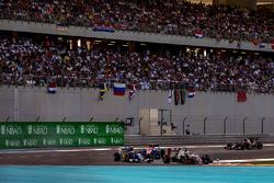 Romain Grosjean, Haas VF-16, leads Felipe Nasr, Sauber C35, and Esteban Ocon, Manor MRT05