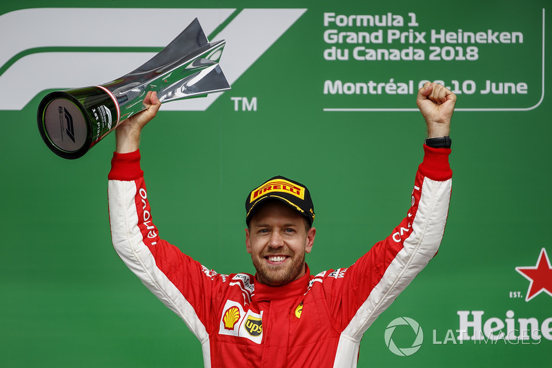 Sebastian Vettel, Ferrari, 1st position, celebrates with his trophy on the podium