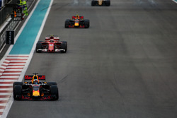 Daniel Ricciardo,  Red Bull Racing RB13, leads Kimi Raikkonen, Ferrari SF70H, and Max Verstappen,  Red Bull Racing RB13