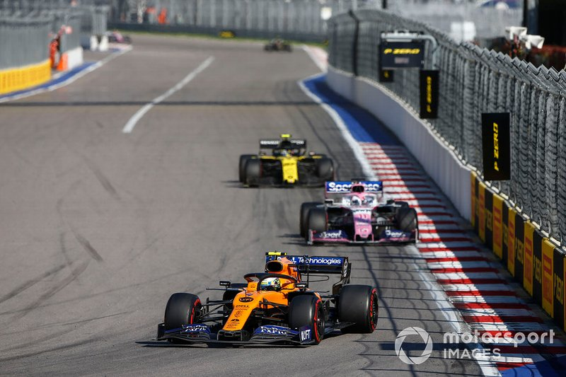 Lando Norris, McLaren MCL34, leads Sergio Perez, Racing Point RP19, and Nico Hulkenberg, Renault F1 Team R.S. 19