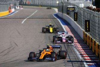 Lando Norris, McLaren MCL34, leads Sergio Perez, Racing Point RP19, and Nico Hulkenberg, Renault F1 Team R.S. 19