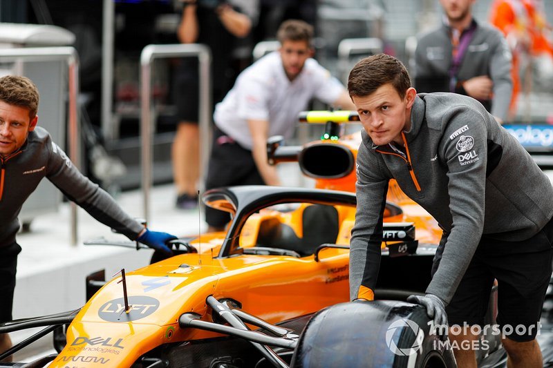 McLaren mechanics push the Lando Norris McLaren MCL34