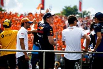 Carlos Sainz Jr., McLaren, Max Verstappen, Red Bull Racing, Lando Norris, McLaren, and Alexander Albon, Toro Rosso, in the drivers parade