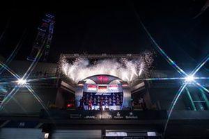 I–aki Rueda, Head of Strategy, Ferrari, Sebastian Vettel, Ferrari, 1st position, Charles Leclerc, Ferrari, 2nd position, and Max Verstappen, Red Bull Racing, 3rd position, celebrate with Champagne on the podium