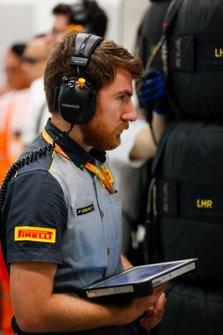A Pirelli technician at work in the McLaren garage