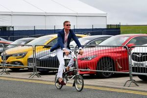 David Coulthard arrives on a bike