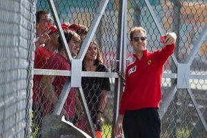Sebastian Vettel, Ferrari takes a selfie with a fan
