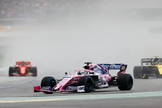 Sergio Perez, Racing Point RP19, leads Nico Hulkenberg, Renault F1 Team R.S. 19, and Sebastian Vettel, Ferrari SF90
