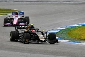 Kevin Magnussen, Haas F1 Team VF-19, leads Lance Stroll, Racing Point RP19