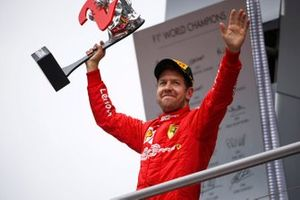 Sebastian Vettel, Ferrari, 2nd position, on the podium with his trophy