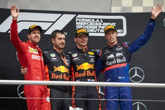 Sebastian Vettel, Ferrari, 2nd position, Guillaume Rocquelin, Head of Race Engineering, Red Bull Racing, Max Verstappen, Red Bull Racing, 1st position, and Daniil Kvyat, Toro Rosso, 3rd position, on the podium